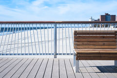 Bench on wooden Pier, background Royalty Free Stock Photo