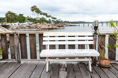 Bench wooden in restaurant at pier sea view. Stock Photos