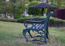 Bench on yard. A bench on the green grass in a yard Stock Image