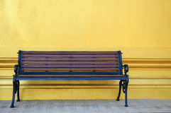 Bench. With yellow wall background Royalty Free Stock Image