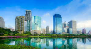 Benchakitti Park near the skyscraper business district,Bangkok city. With park at twilght with reflection of skyline, Bangkok,Thailand Royalty Free Stock Photography