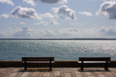 Benches. By the sea in summer sunshine royalty free stock photo