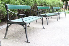 Benches adn seats in a park. Two green benches adn seats in a park royalty free stock photography