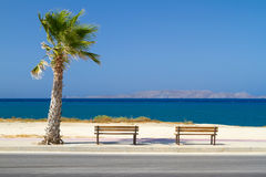 Benches at Aegean sea. On Crete, Greece Stock Image