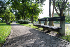 Benches along the footpath at Suan Luang Rama 9 Park Royalty Free Stock Images