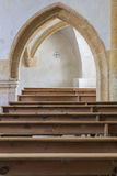 Benches and arch. In the church Stock Photography