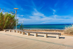 Benches on the beach in front of the sea with  sun light, select Stock Photos