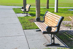 Benches at a beach park. Pair of metal and wooden benches at a beach park in St. Petersburg, Florida Stock Photos