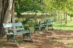 Benches in big garden for relaxing Stock Photos