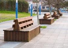 Benches in row Stock Photos