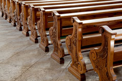Benches in catholic curch at cortina d'ampezzo. In the italian dolomites Royalty Free Stock Image