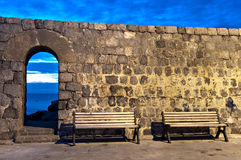 Benches in Cefalù. Cefalù, Sicily. Benches and the arch stock images
