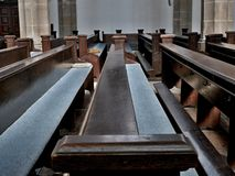 Benches in church Stock Images