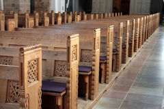 Benches in a church. A shot of wooden benches inside a church in Rome Stock Photos