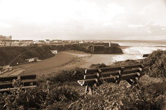 Benches on a cliff edge  with views of Ballybunion in sepia Stock Images