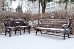 Snow-covered benches at the corner Stock Images
