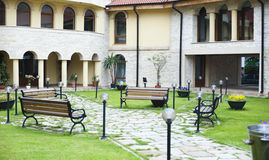Benches in courtyard. Benches in a building courtyard with walkways and globe light posts Royalty Free Stock Images