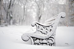 Benches covered with snow in winter Stock Photo