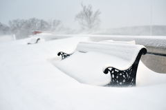 Benches covered with snow in winter Stock Photos