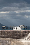 Benches with a dark sky with rays of sunshine Stock Photography