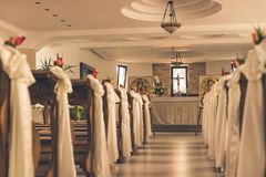 Wedding decoration church stock photos royalty free pictures wedding decoration church benches decorated for a wedding in a church in romania stock photography junglespirit Gallery