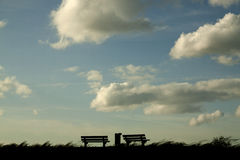 Benches on a dike Stock Photos