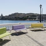 Benches on the embankment of Malta. Colorful park benches on the embankment of Valletta. Promenade on the background of the bay in Malta Stock Image
