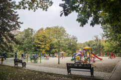 Benches facing playground Stock Photos