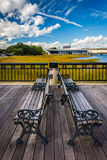 Benches on the fishing pier in Charleston, South Carolina. Royalty Free Stock Photo