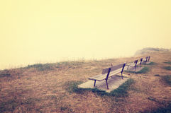 Benches on a foggy cliff Royalty Free Stock Image