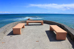 Benches in front of the sea Stock Images