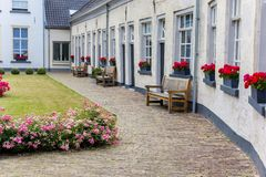 Benches in front of white houses in Doesburg. Netherlands royalty free stock photo