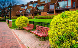 Benches and houses along the Waterfront Promenade in Canton, Bal Stock Photo