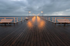Benches and lamp posts on a pier Royalty Free Stock Photography