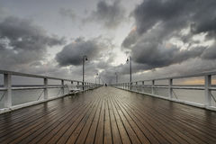Benches and lamp posts on a pier Stock Photography