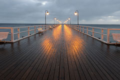 Benches and lamp posts on a pier Royalty Free Stock Photos