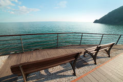 Benches at Ligurian sea. Royalty Free Stock Image