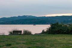View from a bench. Benches looking out over Puget Sound with a boat in the distance Royalty Free Stock Image