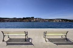 Benches in Mali Losinj. Benches on the seafront of Mali Losinj, Croatia, a popular tourist destination Royalty Free Stock Image