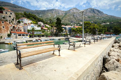 Benches in Mlini. A row of benches on pier at Dubrovnik riviera in Mlini, Croatia royalty free stock photo