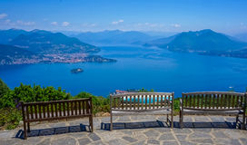 Benches in a mountain with a view to a lake. Three benches in a mountain with a view to a lake stock photos