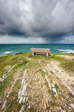 Benches near sea with stormy clouds Royalty Free Stock Images