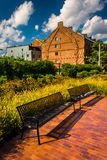 Benches and old brick building in Boston, Massachusetts. Stock Photo