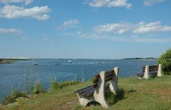 Benches Overlook Essex River. Benches overlooking the Essex River, Essex, MA, on a clear summer day stock images