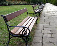 Benches in Park. Some empty benches waiting for lovers in a beautiful autumn day stock image