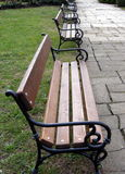 Benches in Park. Some empty benches waiting for lovers in a beautiful autumn day royalty free stock photography