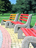 Benches in the park. Blank colored wooden benches in the park Royalty Free Stock Photo