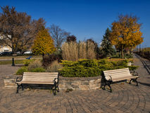 Benches in Park. Romantic benches  in peaceful park in fall Royalty Free Stock Image