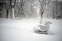 Benches in the park covered with snow Stock Photography