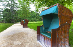 Benches in the park. Benches in the form of coaches in the park Stock Photo